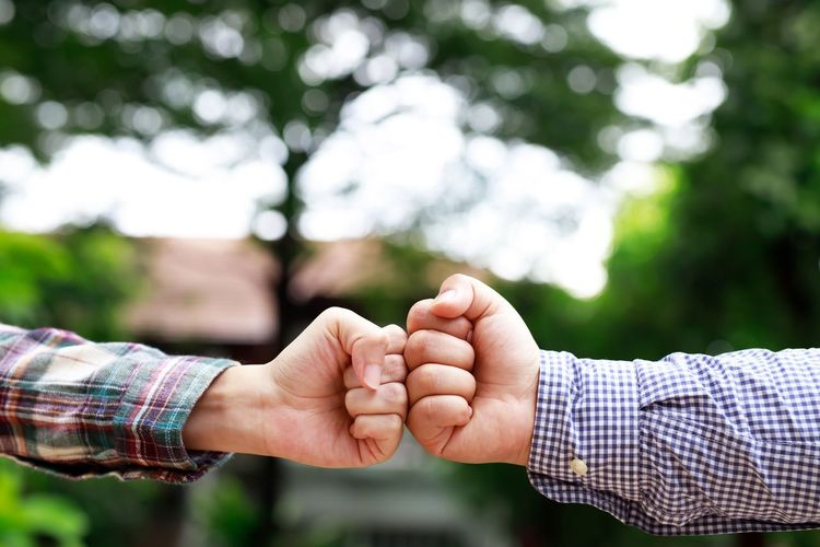Midsection of man holding hands