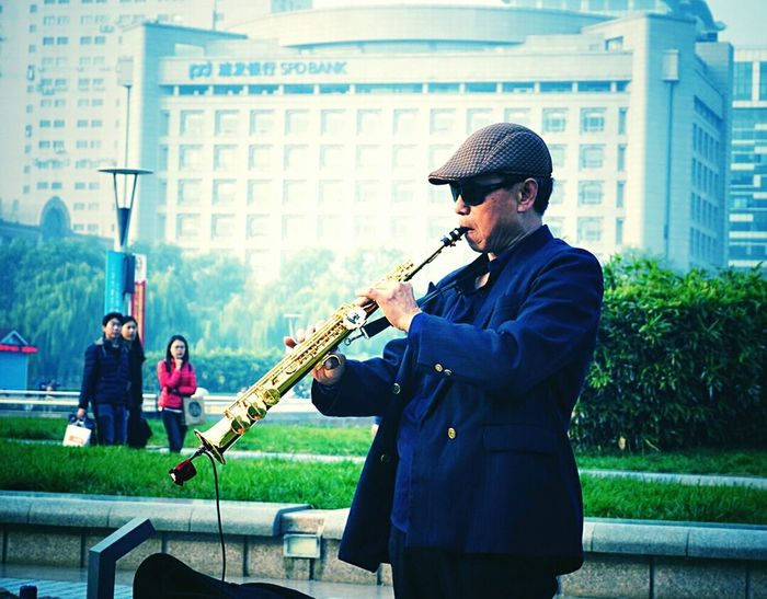 TakeoverMusic Playing Musical Instrument Music Musician Only Men Arts Culture And Entertainment Men Young Adult Performance Adult Skill  People Adults Only Saxophone One Man Only Outdoors Popular Music Concert Jazz Music Day