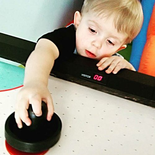 Air Hockey Toddler  Air Hockey Indoors  Boys Child Childhood Human Body Part One Person Males  People Human Hand One Boy Only Day Close-up