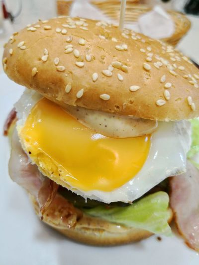 Hamburger with fried egg Fried Egg Fried Convenient Convenience Food Close-up Food And Drink Pub Food Ketchup Hamburger CheeseBurger Sesame Condiment Sesame Seed Burger Bun Deep Fried  Fast Food French Fries Cheddar - Cheese Mayonnaise French Fries Mustard Chicken Wing Wax Paper Processed Meat Take Out Food Omelet Deep Fried  Sandwich Fast Food Restaurant English Breakfast