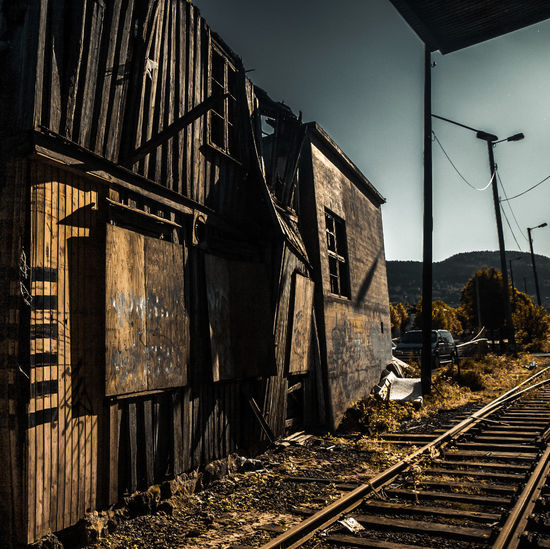 Railway tracks along abandoned built structures