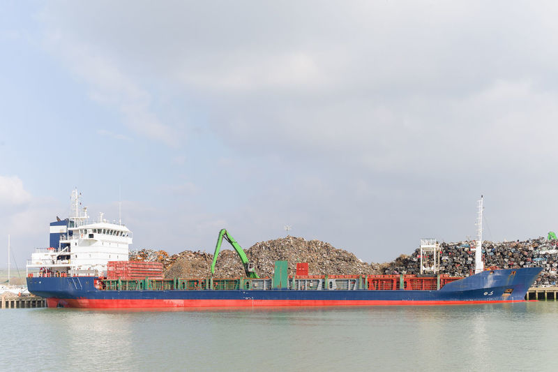 Cargo Container In Sea Against Cloudy Sky