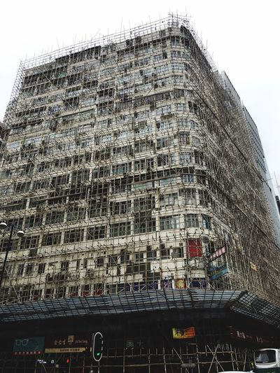Built Structure Building Exterior Architecture Outdoors Low Angle View HongKong Bamboo Shelter Bamboo Shelves Renovation Working At Heights Intensive Dangerous Beauty No People IPhone