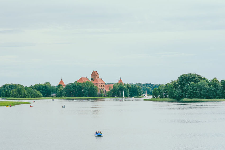 Trakai Castle Architecture Beauty In Nature Building Exterior Built Structure Day Lietuva Nature No People Outdoors Place Of Worship Religion Scenics Sky Spirituality Trakai Trakai Castle Trakai Island Castle Traveling Tree Water