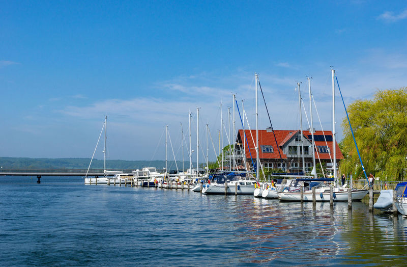 small harbor in the village seedorf on Rügen island Nautical Vessel Transportation Mode Of Transportation Water Waterfront Pole Blue Cloud - Sky No People Architecture Mast Nature Day Reflection Outdoors Yacht Sky Port Moored Anchored Sailboat Harbor Sea Marina