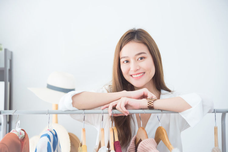 Owner Business Shop Store Retail  Clothing Woman Fashion Clothes Small Young Female Smiling Standing Beautiful Sales Businesswoman Adult person Indoors  People Portrait Designer  Occupation Confident  Looking Smile Working Work Job Positive Happy SME Joy Asian  Chinese Korean Japanese  Thai