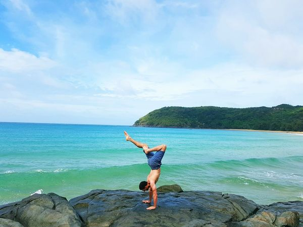 Handstand on the Beach Sea One Person Outdoors Beach Sky Nature Fitness Gym Handstand  Water Nature Vacations Cloud - Sky Handstand  Blue Yoga Namaste ❤ Vacation Time Playa Karate Miles Away