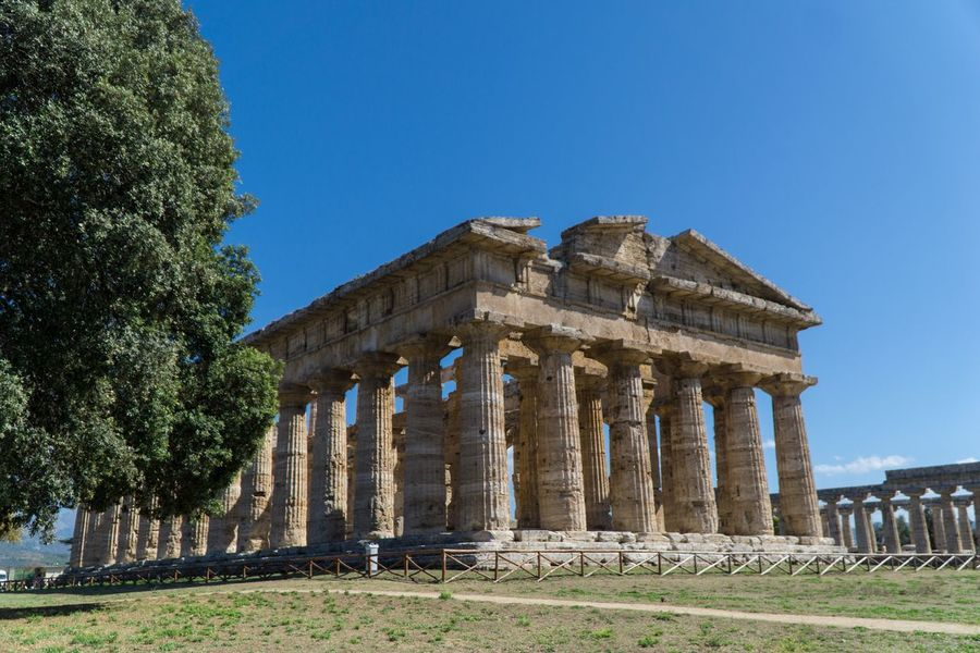 Paestum Roman ruins, Italy Temple Of Neptune Temple Roman Ruins Architecture Sky History The Past Built Structure Architectural Column Ancient Building Exterior Travel Destinations Clear Sky Blue Travel Day Tourism Plant Old Ruin Ancient Civilization Nature Tree Low Angle View
