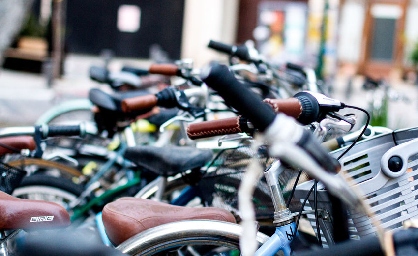 Close-up of bicycle parked in parking lot