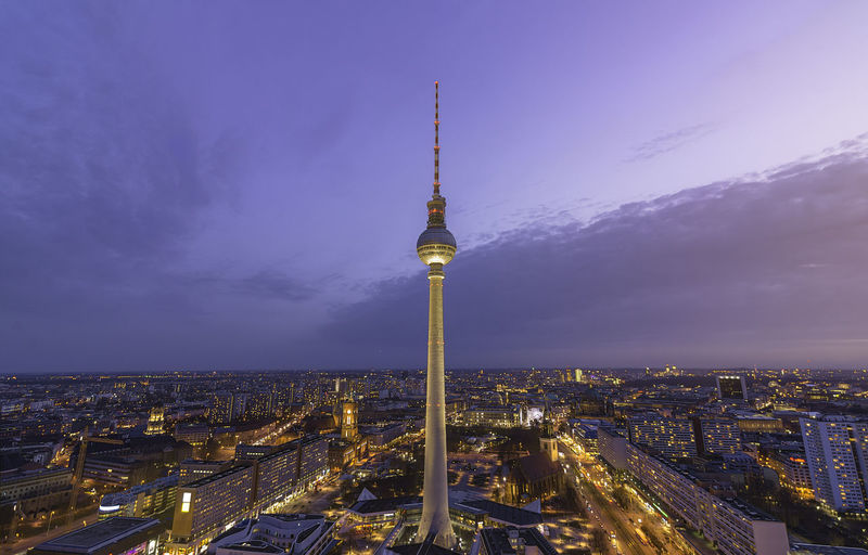 Illuminated Television Tower - Berlin Amidst Buildings Against Sky During Sunset