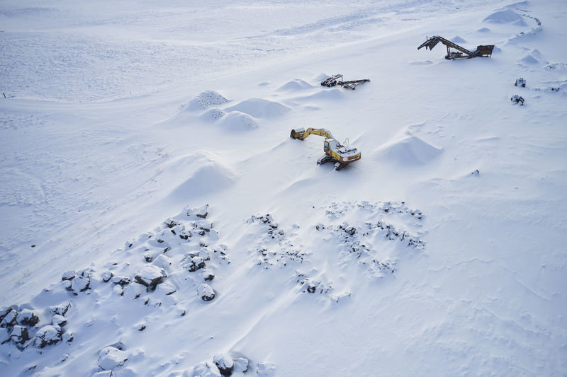High angle view of people skiing on snow