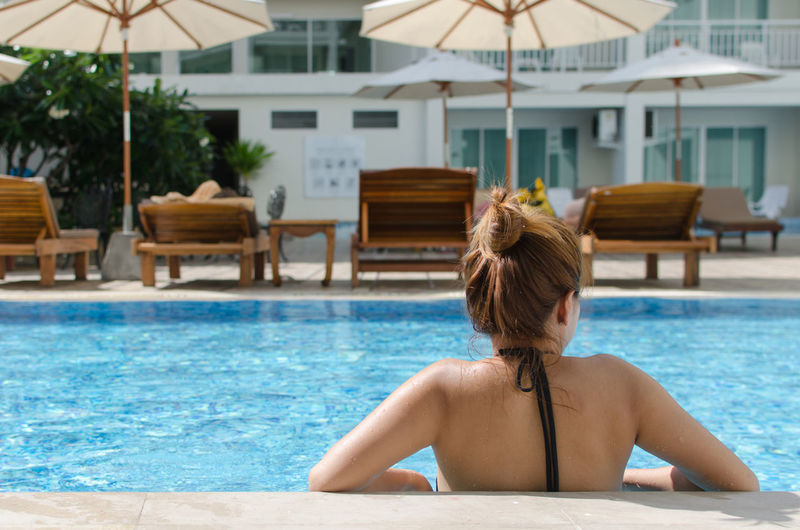 Rear view of woman in swimming pool