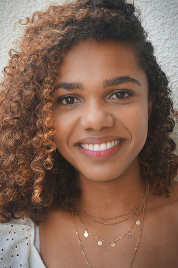 Close-up portrait of a smiling young woman