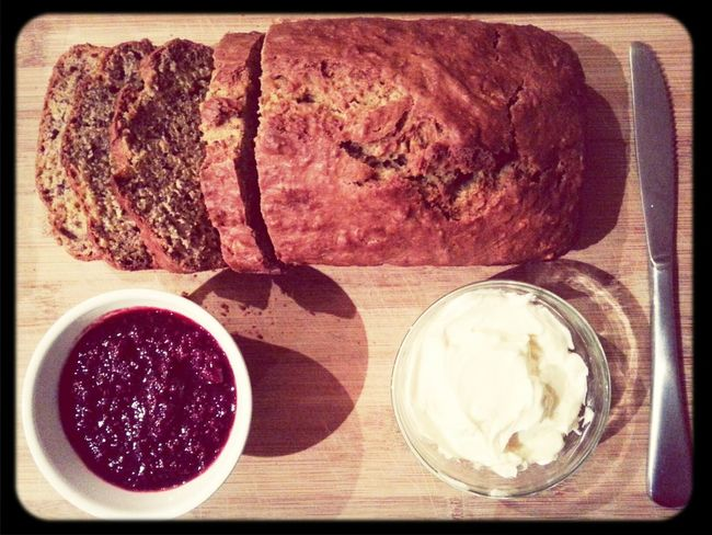 Midnight Banana Bread with fresh raspberry coulis and cream cheese