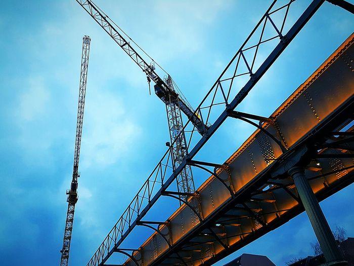 Berlin, city of construction, cityexplorer , bridges , cranes , Berliner Ansichten , blue hour , looking up , no people Bridge Skeleton Evening Light