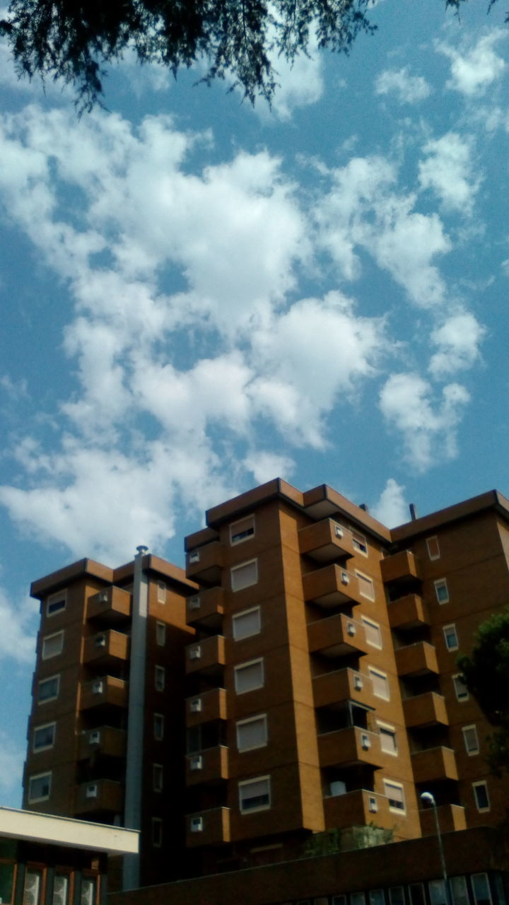 built structure, architecture, building exterior, sky, cloud - sky, low angle view, building, nature, no people, residential district, day, city, outdoors, apartment, window, modern, sunlight, pattern, tree, city life
