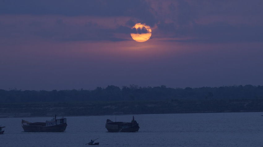SUNRISE ON TEH BANKS OF PADMA RIVER Beauty In Nature Day Horizon Over Water Mode Of Transport Moon Moored Mountain Nature Nautical Vessel No People Outdoors Scenics Sea Silhouette Sky Sunrise Sunset Tranquil Scene Tranquility Transportation Tree Water
