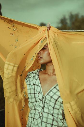 Woman holding yellow umbrella