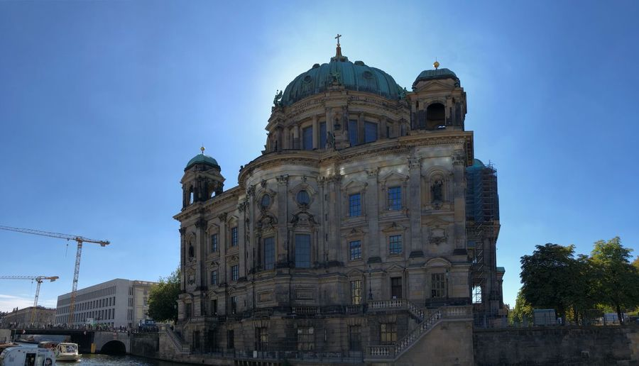 Berlin cathedral against clear blue sky in city
