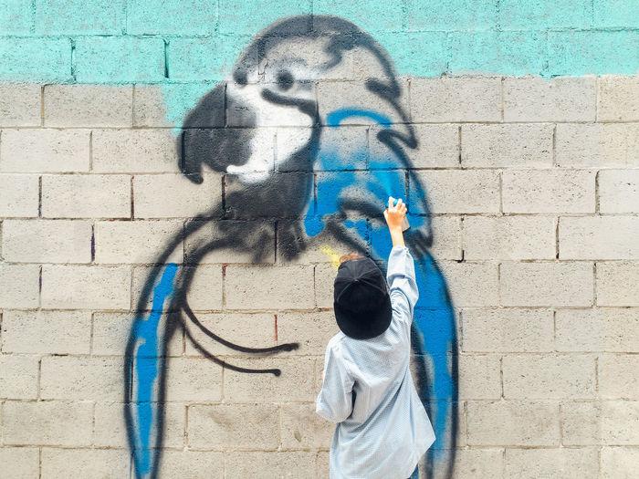 Art Artattack Barcelona Birds Communication Creativity Creativity Day Front View Graffiti Graffiti Human Representation Kids Lifestyle Multi Colored One Person Person Street Art Street Artists Urban Wall - Building Feature