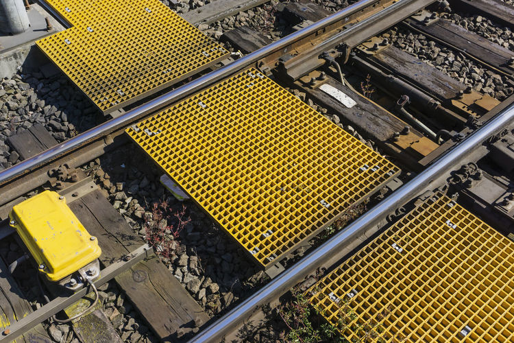 Yellow heavy duty grating over railroad track for service personnel Berlin Germany 🇩🇪 Deutschland Heavy Duty Horizontal Service Color Image Connection Day Equipment Grating High Angle View Industry Metal Mode Of Transportation No People Outdoors Pattern Personnel Rail Transportation Railroad Track Technology Transportation Yellow