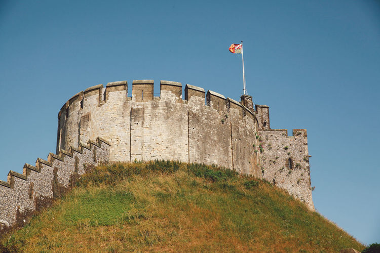 Low angle view of arundel castle against clear sky