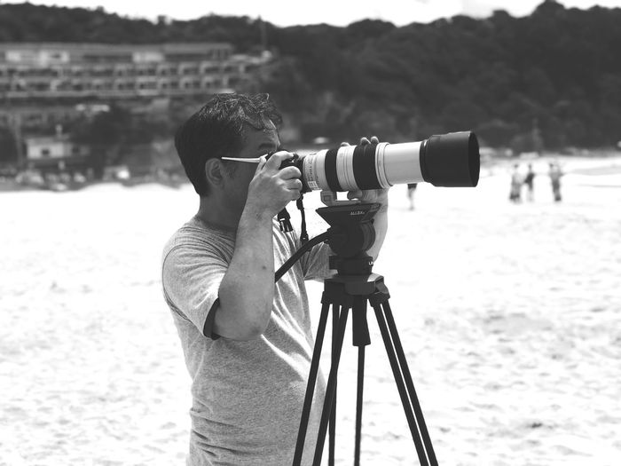 Man photographing camera on land