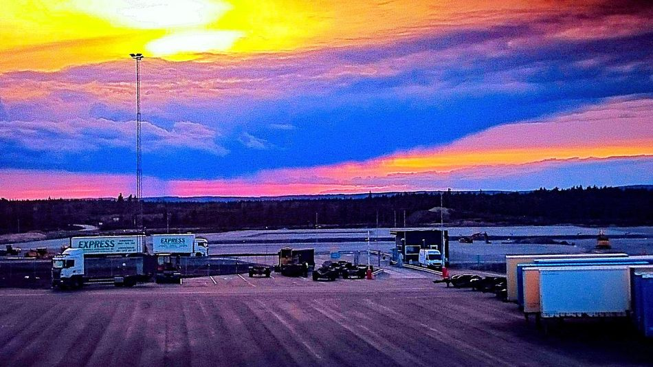 sun down Sweden The True Story Summer Exploratorium Multi Colored Illuminated Sunset Road Sign Road Land Vehicle Car Sky Cloud - Sky