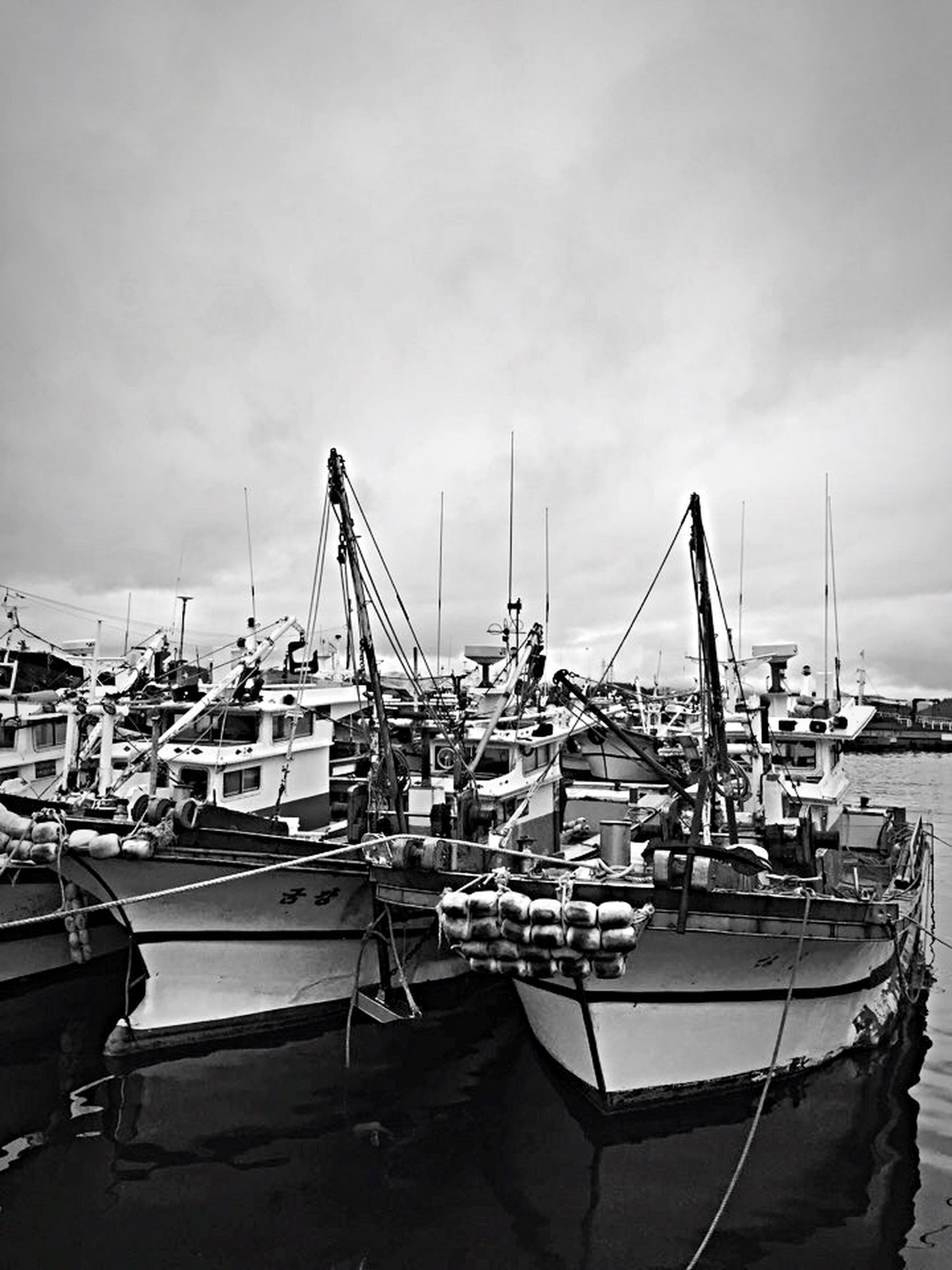 nautical vessel, moored, harbor, transportation, boat, mode of transport, mast, commercial dock, sky, water, sea, crane - construction machinery, cloud - sky, sailboat, development, built structure, freight transportation, building exterior, outdoors, industry