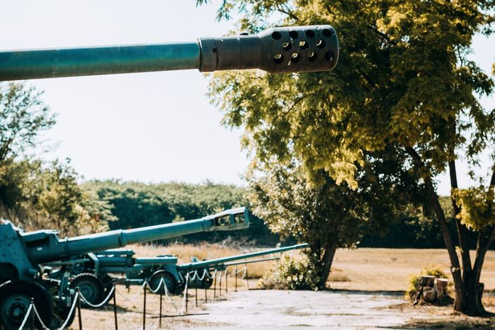 Cannon Weapons Of War Weapon War Sunlight Day Tree No People Close-up Clear Sky Sky Outdoors Nature