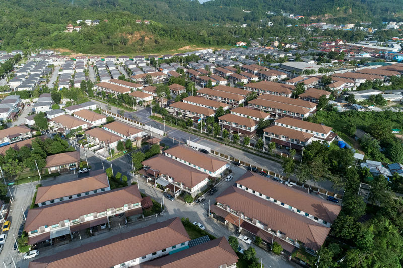 Aerial View Architecture Building Building Exterior Built Structure City Cityscape Community Day Government High Angle View House Nature No People Outdoors Plant Residential District Road Roof Town Transportation Tree