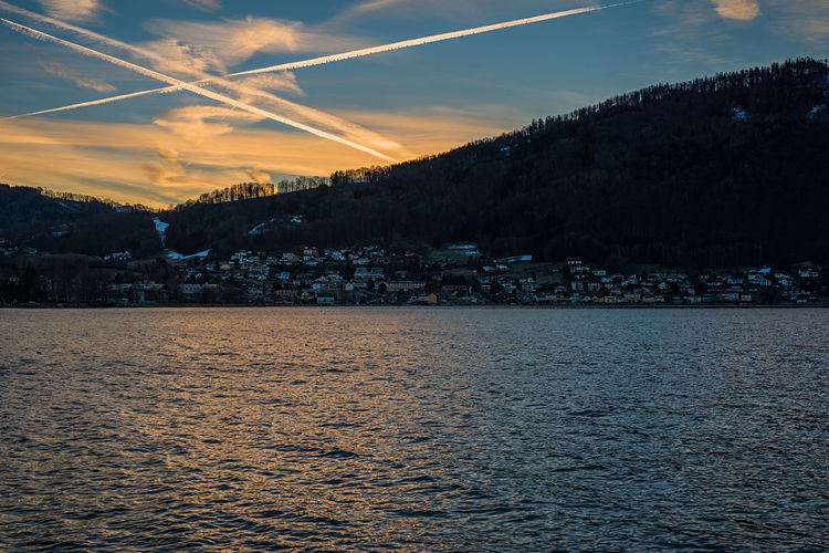 Das X Am Himmel Omen Traunsee Lake Salzkammergut, Austria Morgenstimmung Water Sky Waterfront Cloud - Sky Beauty In Nature Scenics - Nature Architecture Sunset Built Structure No People Nature Tranquil Scene Tranquility Sea Building Exterior City Mountain Idyllic Building Outdoors View Into Land