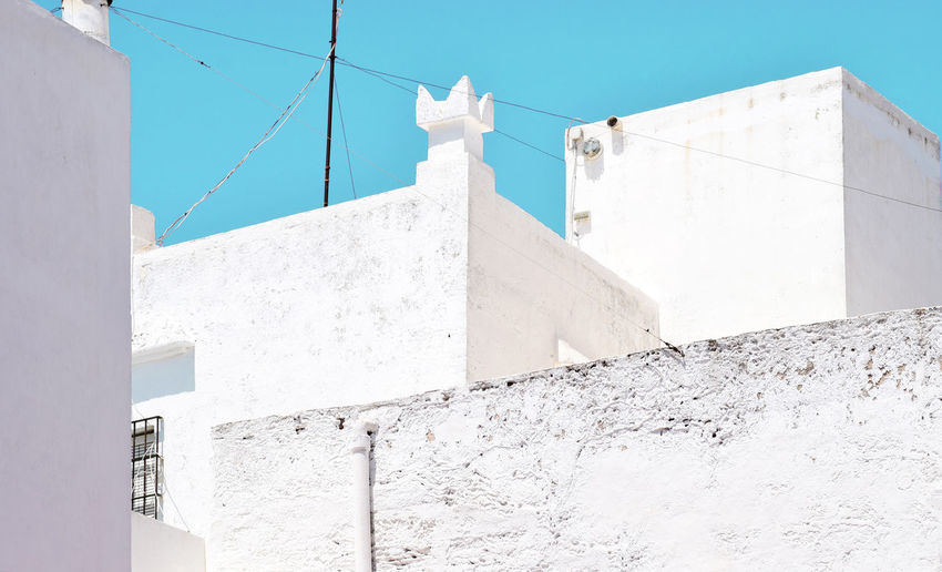 White architecture of Andalusia on the bright azure sky. Abstract architectural form Andalucia Rural Andalucia Spain Andalucía Arabian Architecture Bright Formation Abstract Arabic Architecture Azure Window Building Building Exterior Built Structure Clear Sky Concrete Day No People Rotary Phone Sunny Wall Wall - Building Feature White White Color