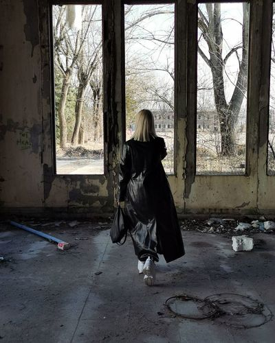 Rear view of woman in abandoned building