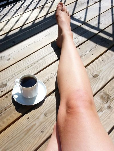 Low Section Of Woman By Black Coffee Cup