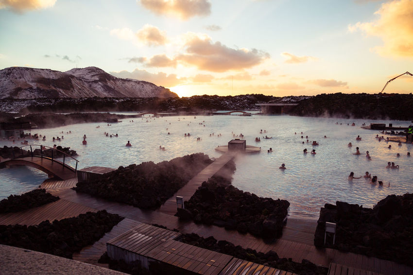 The Blue Lagoon in Iceland during winter. Bathing Blue Lagoon Day Geothermal  Geothermal Spa Iceland Lagoon Luxury Outdoors Scenics Sky Sunset Swimming Tourism Tourist Tourists Travel Travel Destinations Traveling Volcanic  Water Winter