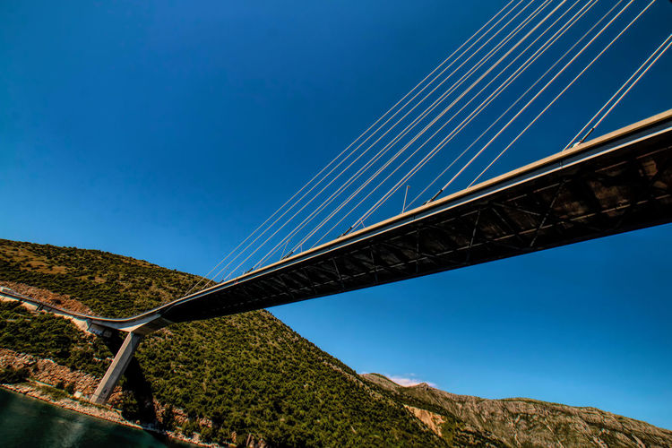 A modern bridge spanning a waterway to Dubrovnik, Croatia Bridge - Man Made Structure Bridge Dubrovnik, Croatia Bridge Span Cables Low Angle View Eastern Europe Architecture