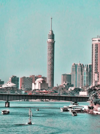 City Skyscraper Tower Travel Destinations Urban Skyline Architecture Building Exterior No People Modern Nautical Vessel Waterfront Outdoors Cityscape Sky Day Downtown District Water Nature The Nile River