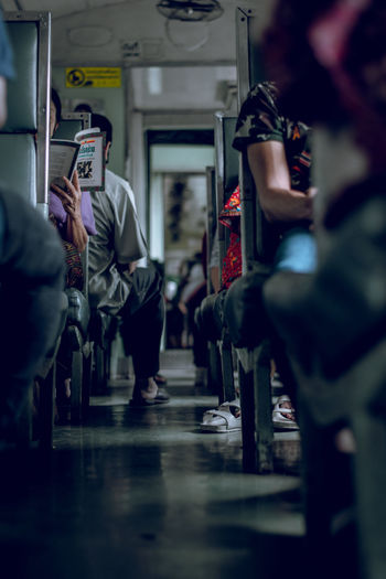 Group Group Of People Indoors  Lifestyles Mode Of Transportation Real People Selective Focus Train Travel
