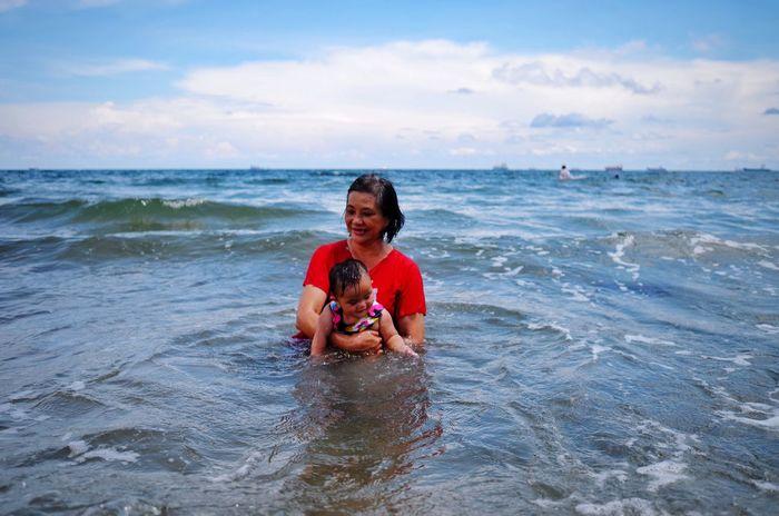 Atiliah and lola having fun at the beach. Day Out Babygirl Lola Grandma Grandmother Sea And Sky Beach Beach Day