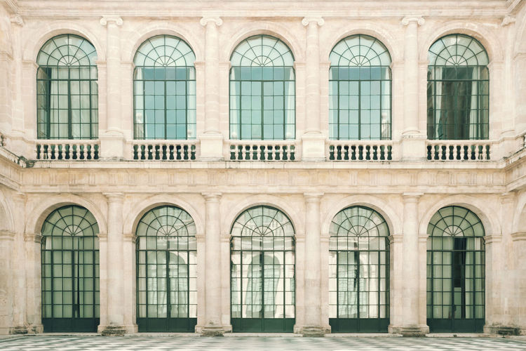 The house of doors Arch Architecture Building Building Exterior Classic Fashion Glass Outdoors Reflections Symmetry Window