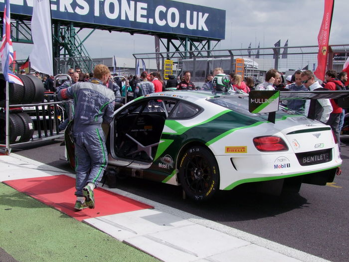 Driver jumping into Bentley on the Grid - 2016 Blancpain GT Series - Endurance Cup Bentley Competition Composition Driver Endurance Racing Full Frame Fun GB Grid GT Incidental People Land Vehicle Leisure Activity Lifestyle Outdoor Photography Parked Protective Clothing Racing Car Silverstone Sports Sports Car Stationary Sunlight And Shadow Uk White, Been And Black Colour