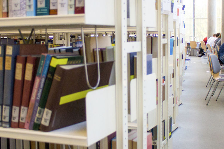 View of books on shelf in library
