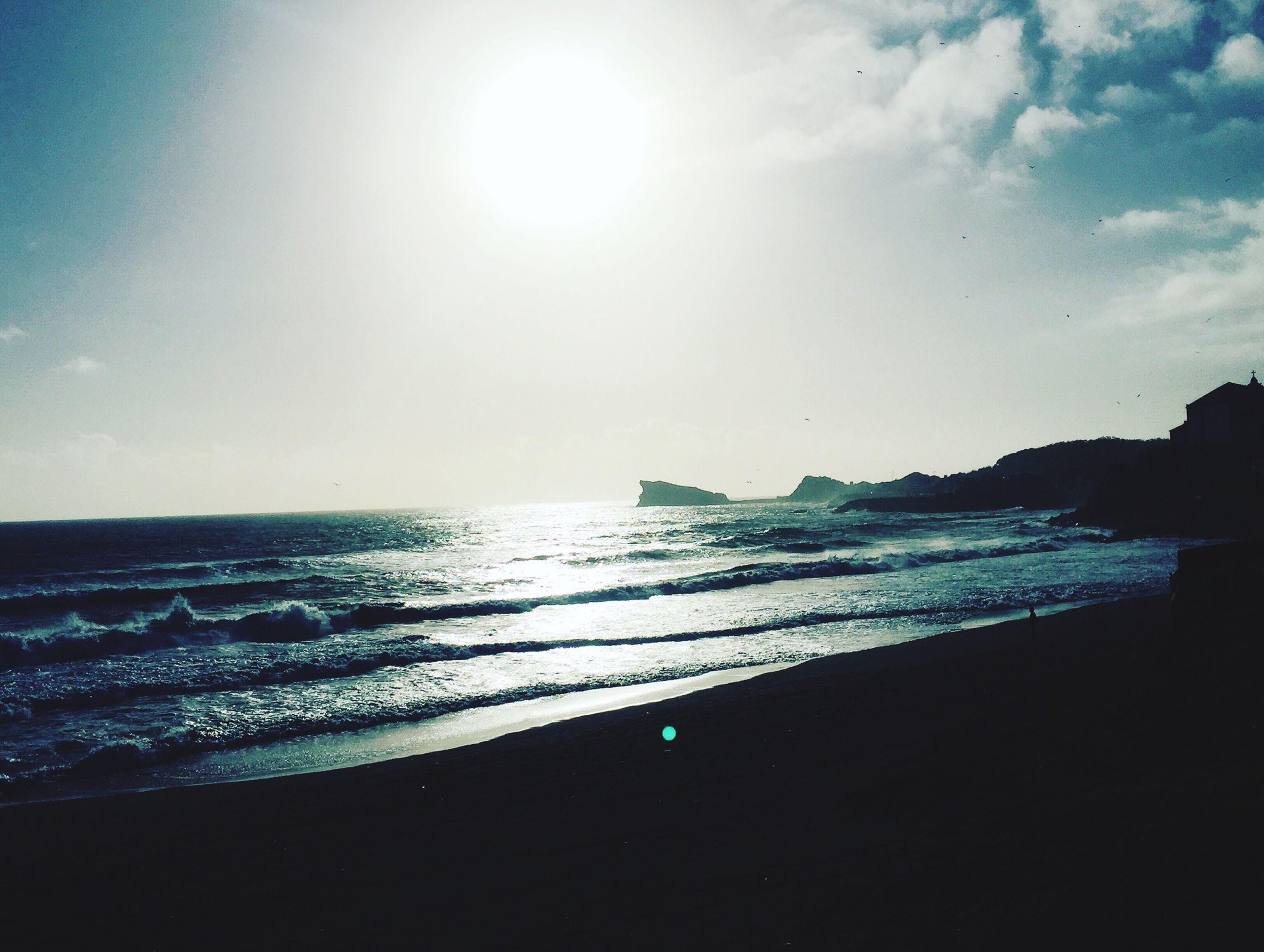 sea, water, horizon over water, tranquil scene, scenics, tranquility, beauty in nature, beach, sky, shore, sun, nature, idyllic, reflection, sunlight, calm, coastline, blue, seascape, outdoors