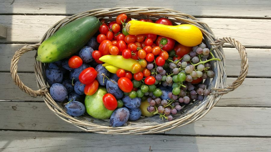 High angle view of fruits and vegetables in wicker basket on table