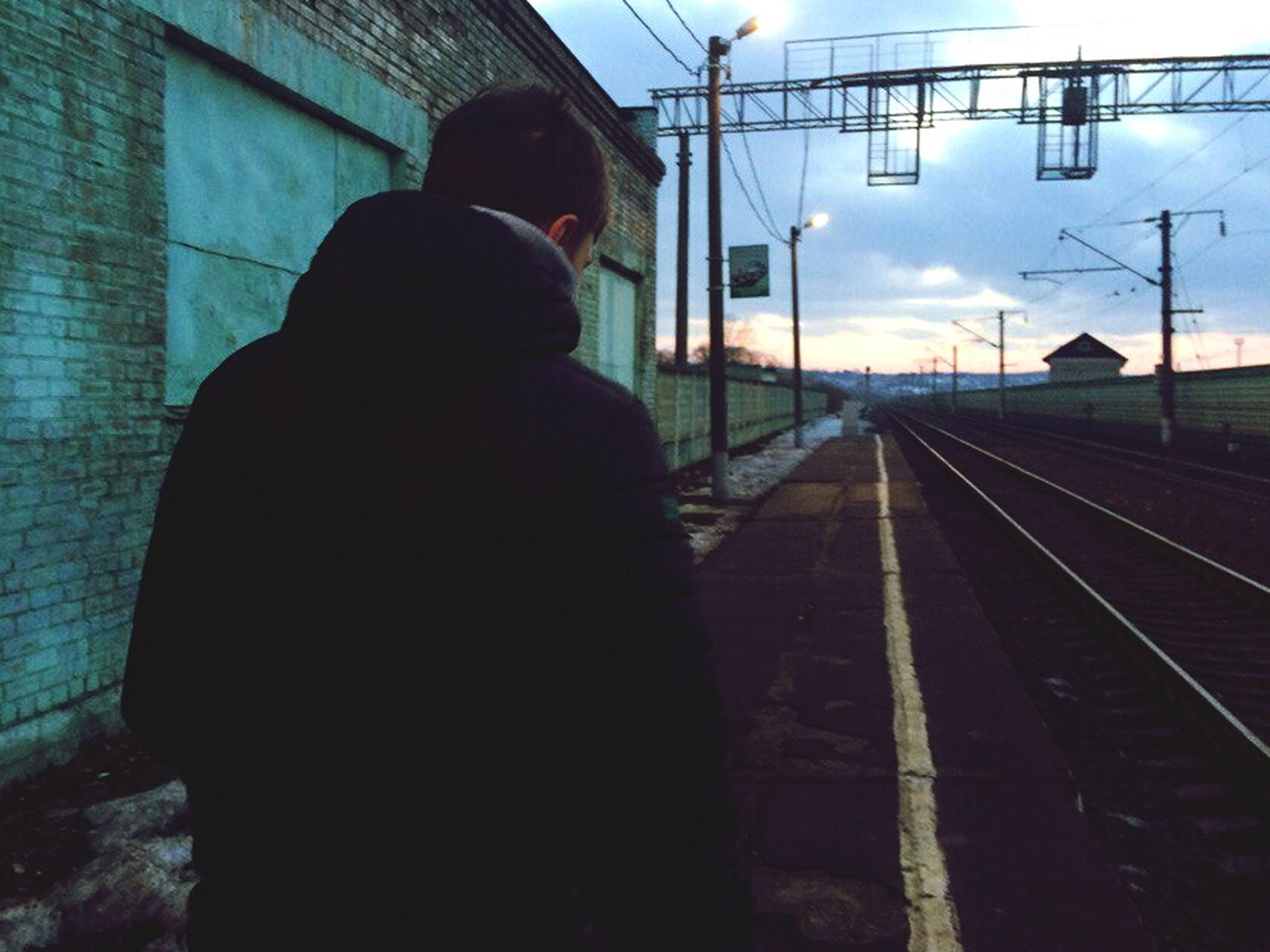 rear view, railroad track, men, transportation, railroad station, real people, silhouette, one person, outdoors, day, nature, people, adult