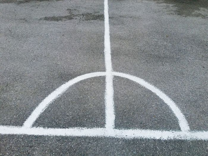 Line and half circle High Angle View Outdoors Sport Backgrounds Textured  Full Frame No People Court White Color Marking Shape Road Sign Single Line Pattern Rough Geometric Shape Half Circle Lines And Shapes Asphalt Road Grey Sport