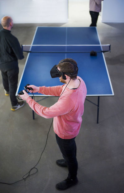 Bright Colors Connected Controllers Cord Gaming Headset Indoors  Man Office Playing Standing Studio Technology Virtual Reality Vr