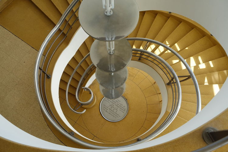 Looking down the spiral staircase at the Pavilion. Abstract Curves And Lines Different Perspective Directly Below Electric Lamp Illuminated Lamp Light Modern No People Pivotal Ideas Spiral Spiral Staircase Spiral Staircase From Above