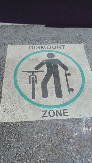 Communication Day High Angle View Human Representation Bicycle Street Transportation Road Outdoors Bicycle Lane Guidance Asphalt Road Sign No People